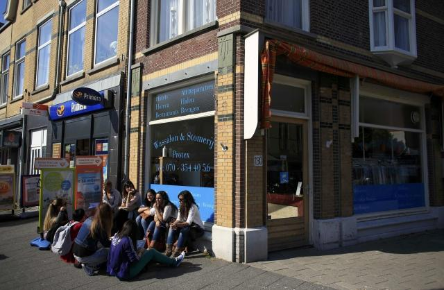 People outside a bank in Netherlands