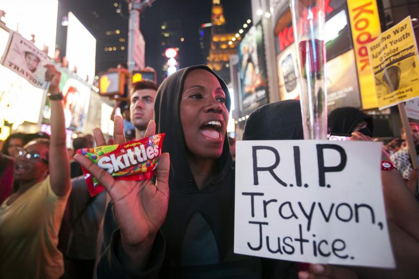 Protester Keisha Martin-Hall holds a bag of Skittles as she participates in a rally in response to the acquittal of George Zimmerman in the Trayvon Martin trial in Times Square in New York