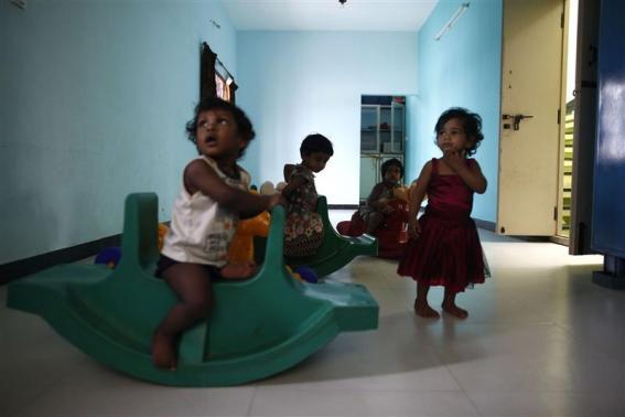 Baby girls play inside the Life Line Trust orphanage in Salem in Tamil Nadu