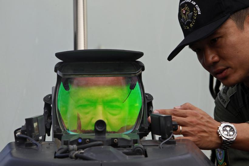 Sultan of Brunei looks through the heads-up display of a Lockheed F-16-D