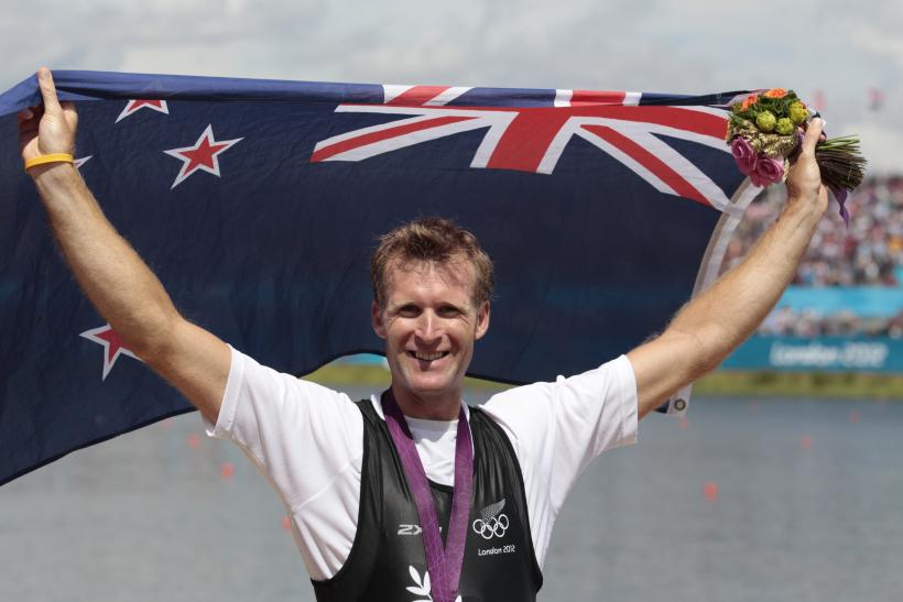 Gold medallist Mahe Drysdale holds national flag