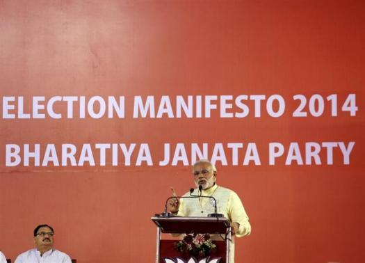 Hindu nationalist Narendra Modi, the prime ministerial candidate for Bharatiya Janata Party (BJP), addresses a gathering after releasing their election manifesto in New Delhi April 7, 2014.