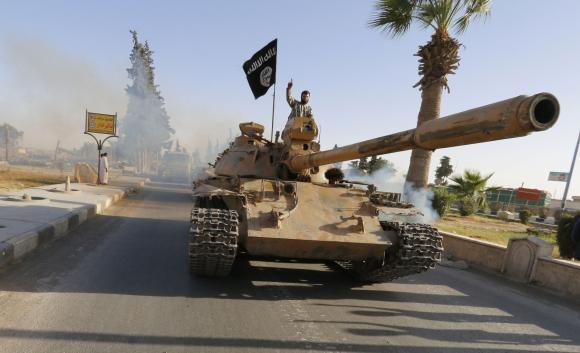 Islamist fighters on tank