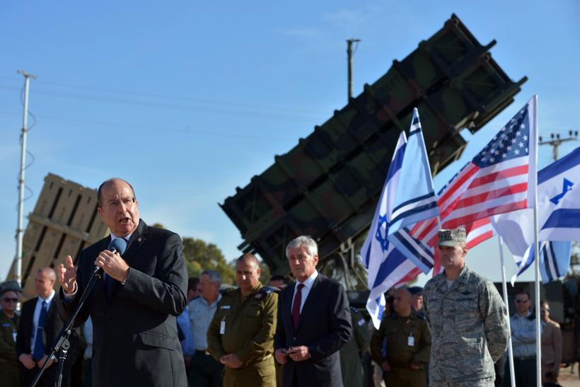 Moshe Yaalon stands in front of Patriot SAM battery