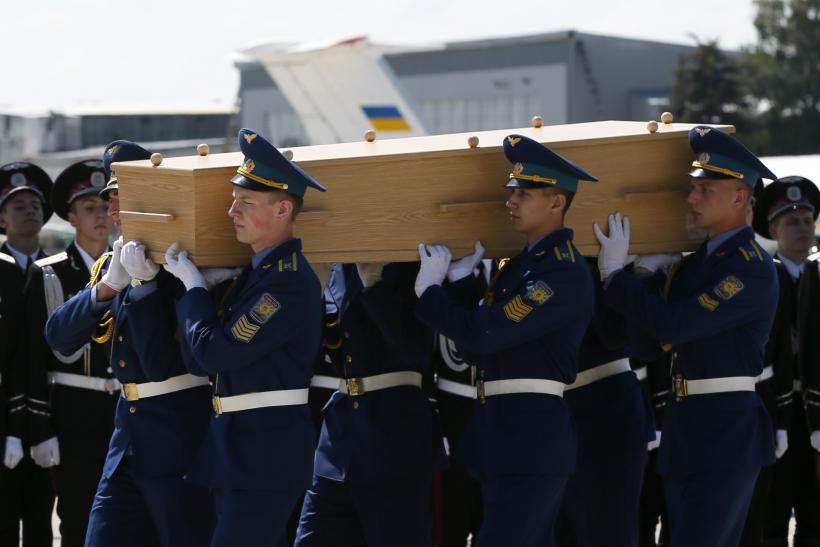 Honour guards carry a coffin of one of the victims of Malaysia Airlines MH17