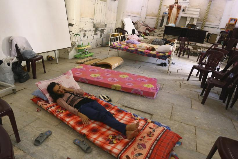 An Iraqi Christian family fleeing the violence in the Iraqi city of Mosul, sleeps inside the Sacred Heart of Jesus Chaldean Church in Telkaif near Mosul, in the province of Nineveh, July 20, 2014.