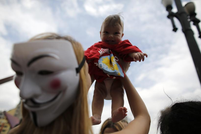 Anonymous holding baby
