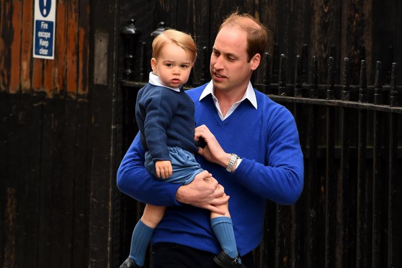 prince william carrying his son prince george on the way to visit his ...