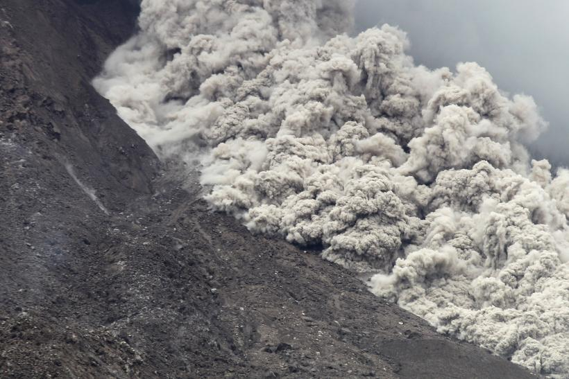 Volcanic ash spew from Mount Sinabung as it erupts, as seen from Kuta Tengah Village in Karo Regency, Indonesia's North Sumatra province, on June 16, 2015. Reuters/YT Haryono