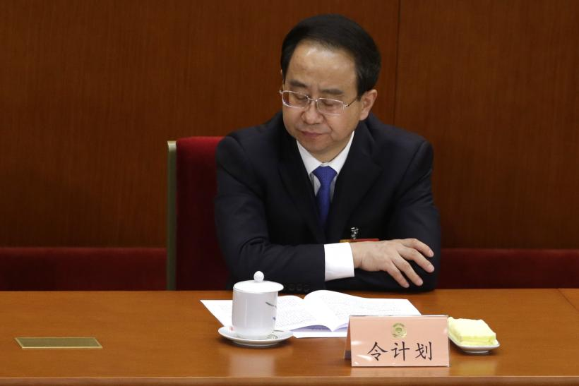 China Investigates Aide To Former President