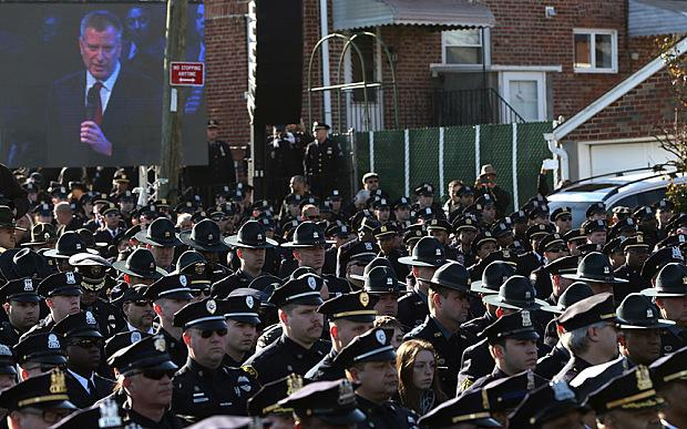 US Officials and 25,000 Police Officers Attend Slain NYPD Cop's Funeral In New York City