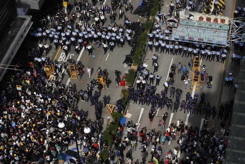 Seven Hong Kong Police Officers Arrested For Assault On Protester