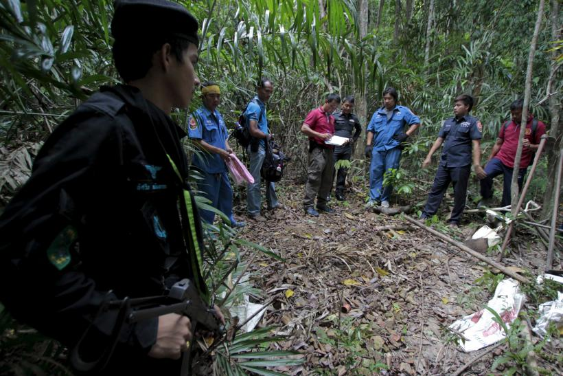 Malaysia migrants mass graves